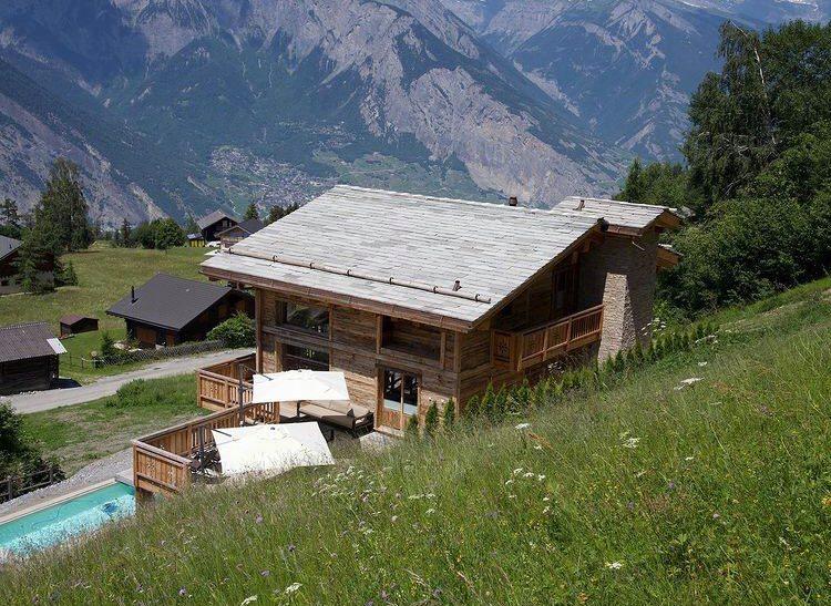 secluded chalets in Switzelrand, summer alpine retreat, remote chalets in Switzerland
